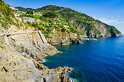 Rocky coastline along the Via dell'Amore (The Way of Love), Riomaggiore, Cinque Terre, Liguria, Italy