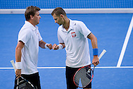 (L) Marcin Matkowski & (R) Mariusz Fyrstenberg both from Poland compete at men's double game during the BNP Paribas Davis Cup 2014 between Poland and Croatia at Torwar Hall in Warsaw on April 5, 2014.<br /> <br /> Poland, Warsaw, April 5, 2014<br /> <br /> Picture also available in RAW (NEF) or TIFF format on special request.<br /> <br /> For editorial use only. Any commercial or promotional use requires permission.<br /> <br /> Mandatory credit:<br /> Photo by © Adam Nurkiewicz / Mediasport