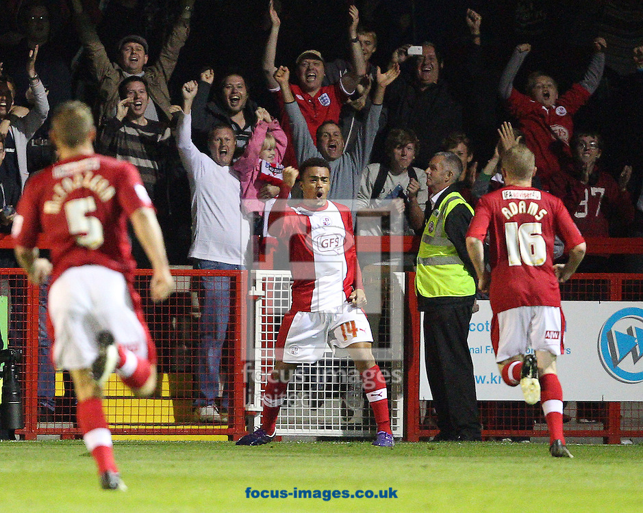 Picture by Paul Terry/Focus Images Ltd +44 7545 642257.28/08/2012.Nicky Ajose ( C ) of Crawley Town celebrates after he scores to make it 2-1 during the Capital One Cup match at Broadfield Stadium, Crawley.