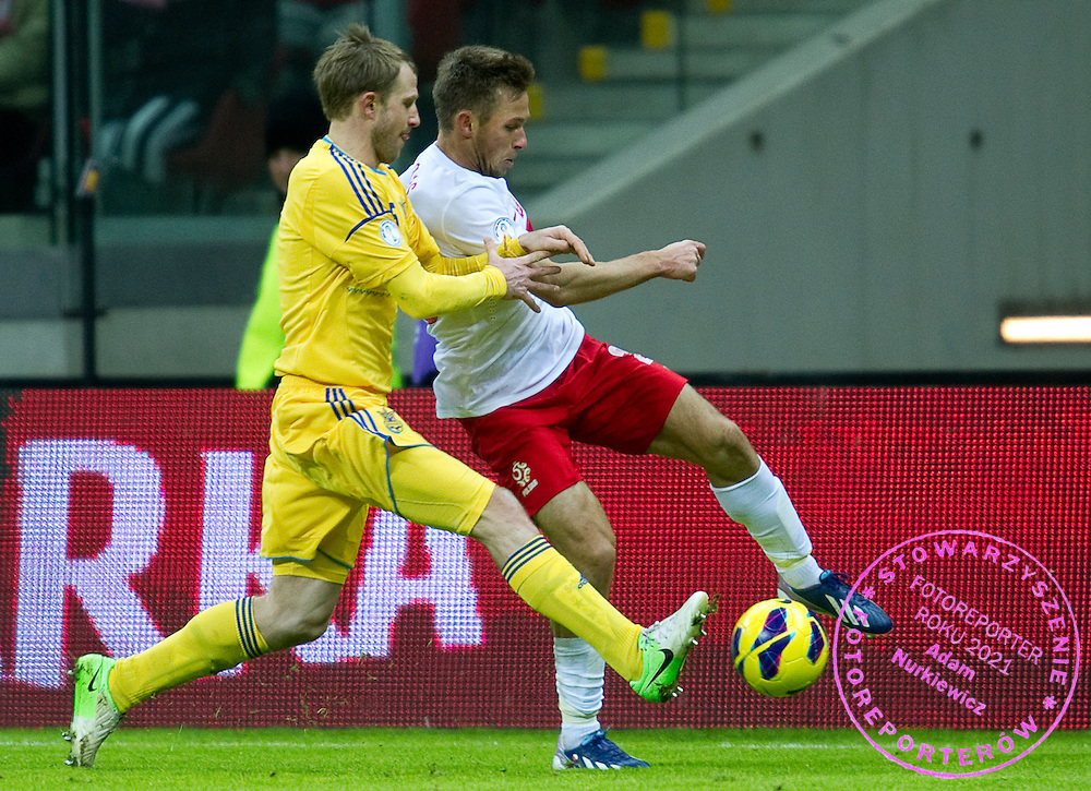 (R) Maciej Rybus of Poland fights for the ball with Oleksandr Kuczer of Ukraine during the 2014 World Cup Qualifying Group H soccer match between Poland and Ukraine at National Stadium in Warsaw on March 22, 2013...Poland, Warsaw, March 22, 2013...Picture also available in RAW (NEF) or TIFF format on special request...For editorial use only. Any commercial or promotional use requires permission...Photo by © Adam Nurkiewicz / Mediasport