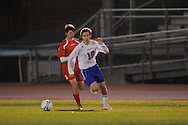 Oxford High's Edward Terry (10) vs. Lafayette High's Austin Fikes (6) in boys high school soccer action at Bobby Holcomb Field in Oxford, Miss. on Monday, December 10, 2012. Oxford won 8-0.