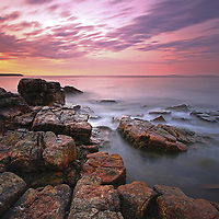 Coastal Maine photography image at sunrise of the rocky seascape and the Atlantic Ocean in Acadia National Park. Seawall is a naturally formed granite and rock seawall located on the southwestern side of Mount Desert Island in Southwest Harbor. I stayed nearby on my recent trip to Acadia and was able to head out early enough to capture the first light at this iconic Acadia NP location.  <br />