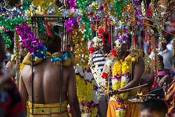 © Licensed to London News Pictures. 03/02/2015. Ipoh, Malaysia. Devotees with metal sticks pieced through their mouths carrying a kavadi dance in front of Kallumalai Murugan Temple in Ipoh, Malaysia, during the Thaipusam Festival,  Tuesday, Feb. 3, 2015. Photo credit : Sang Tan/LNP