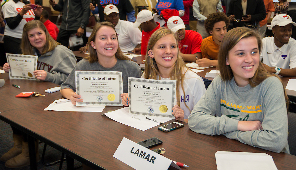 L-R: Lamar's Mary Vanderbloemen (Trinity), Katherine Farmer (Rhoades), Lindsey Lafitte (Northwestern) and McKinley Wade (William and Mary) pose for a photograph during a National Signing Day ceremony at the Region 4 Education Center, February 5, 2014.