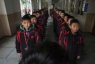 Qingyuan, Guangdong, Chine, le 11 mars 2016<br /> Jeunes pensionnaires align&eacute;s avant de rentrer en classe &agrave; l'&eacute;cole de football Evergrande. Fond&eacute;e en 2013, l'&eacute;cole compte plus de 2000 &eacute;l&egrave;ves et pr&egrave;s de 50 terrains de football.<br /> Gilles Sabri&eacute; pour L'Equipe