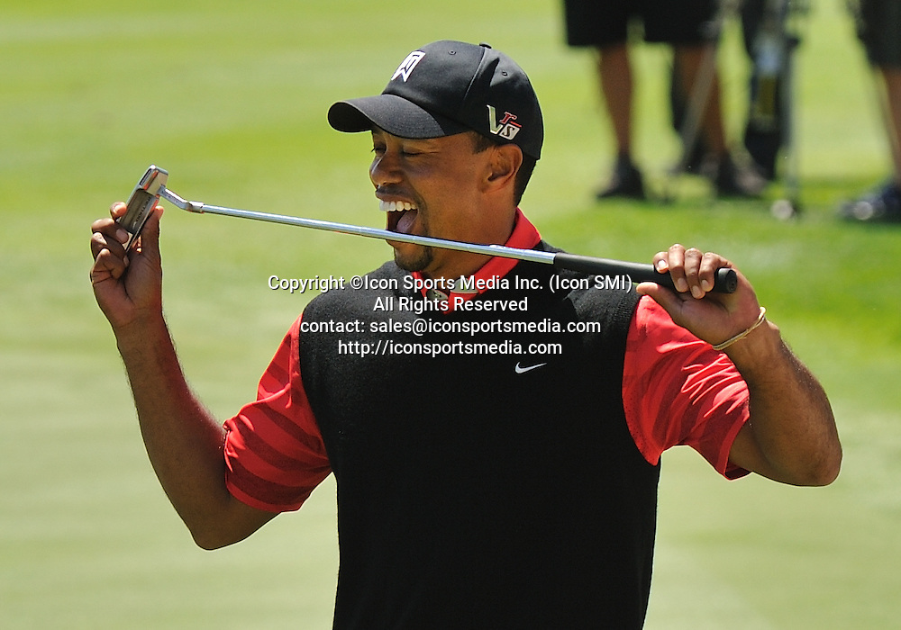 25 March 2013: Tiger Woods bites his putter on the 18th hole during the final round of the Arnold Palmer Invitational at Arnold Palmer's Bay Hill Club & Lodge in Orlando, Florida.