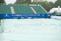 LIVERPOOL, ENGLAND - Friday, June 22, 2012: Rain covers on Centre Court as torrential rain prevents the start of day two of the Medicash Liverpool International Tennis Tournament at Calderstones Park. (Pic by David Rawcliffe/Propaganda)