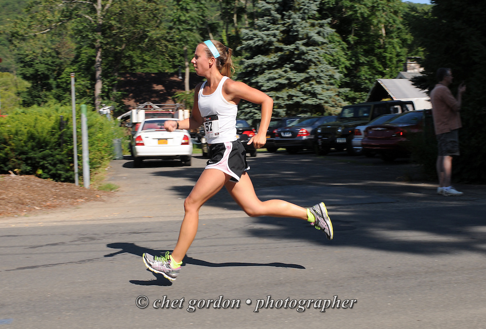 A runner heads toward the finish line during the Greenwood Lake Inaugural 5K Run in Greenwood Lake, NY on Saturday, August 9, 2014.  © Chet Gordon/THE IMAGE WORKS