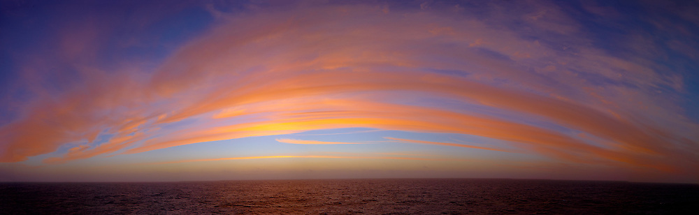 Colorful Clouds at Dawn over the South Atlantic Ocean from the Deck of the Hurtigruten MS Fram. Composite of 16 images taken with a Fuji X-T1 camera and 23 mm f/2 lens (ISO 200, 23 mm, f/8, 1/250 sec). Raw images processed with Capture One Pro and composite panorama created with AutoPano Giga Pro.