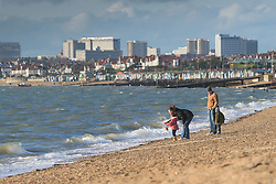 A family on the beach at Thorpe Bay in Southend on Sea in Essex, UK.