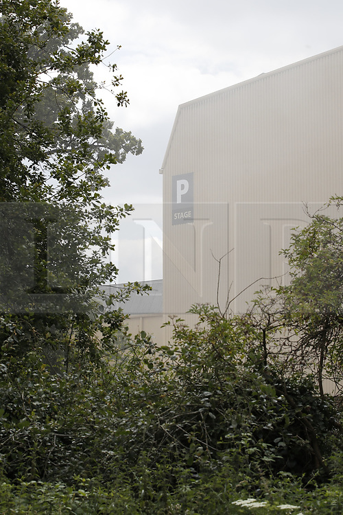 © Licensed to London News Pictures. 11/07/2019. Watford, UK. Smoke can be seen rising from Stage P at the Warner Bros studios at Leavesden near Watford. The fire service were called in overnight after a fire started in one of the studios. The Harry Potter series was filmed here. Photo credit: Peter Macdiarmid/LNP