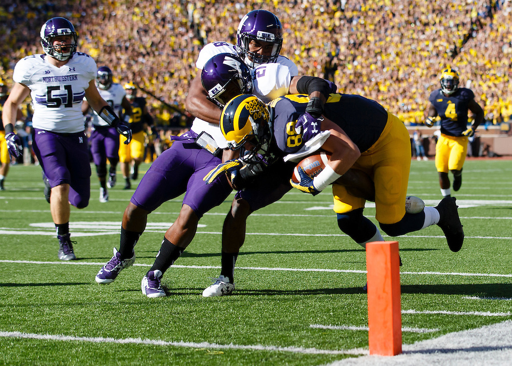 Oct 10, 2015; Ann Arbor, MI, USA; Michigan Wolverines tight end Jake Butt (88) is tackled just short of the end zone by Northwestern Wildcats cornerback Matthew Harris (27) in the first quarter at Michigan Stadium. Mandatory Credit: Rick Osentoski-USA TODAY Sports