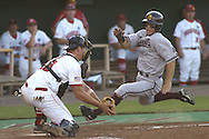 Nebraska catcher Jeff Christy (L) gets ready to tag out Arizona State's Colin Curtis (R) at the plate, in the top of the sixth inning.  Nebraska defeated Arizona State in the first round of the College World Series 5-3 at Rosenblatt Stadium in Omaha, Nebraska on June 17, 2005.