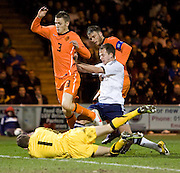 Holland's Jeffrey Gouweleeuw, Bram Nuytinck and keeper Joroen Zoet combine to deny Scotland's Jordan Rhodes - Scotland v Holland - UEFA U21 European Championship qualifier at St Mirren Park..© David Young - .5 Foundry Place - .Monifieth - .Angus - .DD5 4BB - .Tel: 07765 252616 - .email: davidyoungphoto@gmail.com.web: www.davidyoungphoto.co.uk