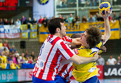 Isais Guardiola od Madrid vs Sebastian Skube of Cimos during 1st Leg handball match between RK Cimos Koper and BM Atletico Madrid (ESP) in Quarterfinals of EHF Champions League 2011/2012, on April 21, 2012 in Arena Bonifika, Koper, Slovenia. (Photo by Vid Ponikvar / Sportida.com)