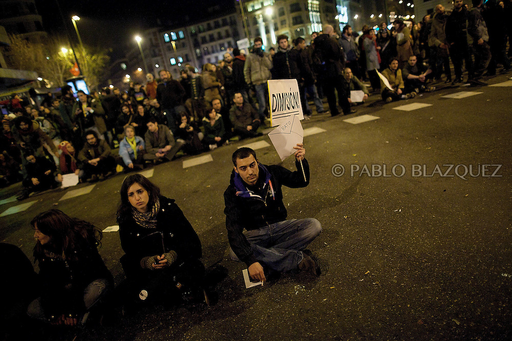 Protesters gather during a demonstration against political corruption and claiming Mariano Rajoy to resign outside the PP headquarters in Madrid on January 31, 2013. The Spanish Newspaper 'El Pais' published secret papers of income implicating Spanish Prime Minister and other members of the PP (Popular Party). Rajoy's government has denied these secret payments.