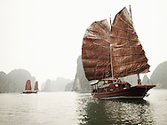 Traditional Vietnamese junks with red weathered sails cruise through Ha Long Bay, a UNESCO World Heritage Site, Vietnam, Southeast Asia