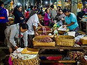 04 AUGUST 2017 - PAYANGAN, BALI, INDONESIA: Shoppers in the local market in Payangan, about 45 minutes from Ubud. Bali's local markets are open on an every three day rotating schedule because venders travel from town to town. Before modern refrigeration and convenience stores became common place on Bali, markets were thriving community gatherings. Fewer people shop at markets now as more and more consumers go to convenience stores and more families have refrigerators.      PHOTO BY JACK KURTZ