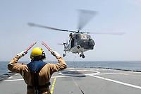 """25 SEP 2006, GOLF VON TADJURA/DJIBOUTI:<br /> Einem Hubschrauber Typ Sea Lynx hebt vom Hubschrauberlandedeck der Fregatte """"Schleswig-Holstein"""" ab. Die Fregatte ist als Flaggschiff Teil des deutschen Marinekontingents der OPERATION ENDURING FREEDOM und operiert im Seegebiet am Horn von Afrika<br /> IMAGE: 20060925-01-099<br /> KEYWORDS: Dschibuti, Bundeswehr, Marine, Soldat, Soldaten, Helicopter, Helikopter, Afrika, Africa"""