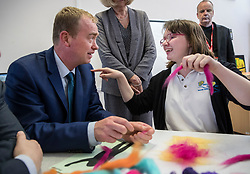 © Licensed to London News Pictures. 16/05/2017. Portsmouth, UK. Liberal Democrat party leader Tim Farron sits with Shanon a student at the Mary Rose Academy special needs school. The Lib Dems have today announced plans for education and business during campaigning for the general election on June 8, 2017.  Photo credit: Peter Macdiarmid/LNP