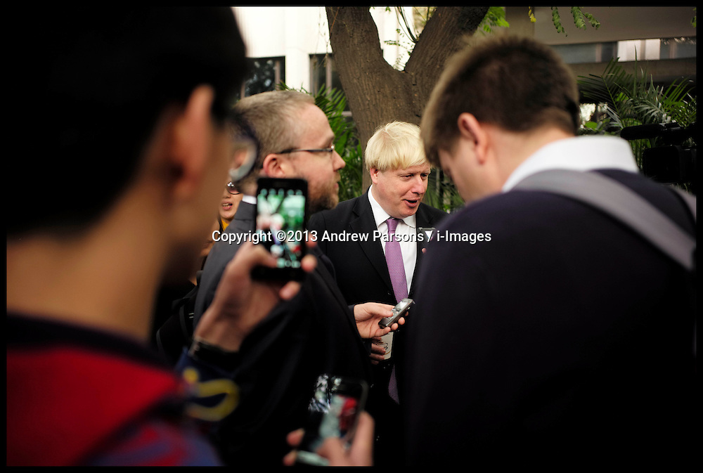 The London Mayor Boris Johnson being interviewed in a  Hutong in Beijing, China, on Day 2 of The Mayor's 6 day trip to China, Monday, 14th October 2013. Picture by Andrew Parsons / i-Images