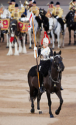 © Licensed to London News Pictures. LONDON, UK  09/06/11. A horse and trooper from the Blues and Royals takes part in Beating the Retreat. On two successive evenings each year in June a pageant of military music, precision drill and colour takes place on Horse Guards Parade in the heart of London when the Massed Bands of the Household Division carry out the Ceremony of Beating Retreat. 300 musicians, drummers and pipers perform this age-old ceremony. The Retreat has origins in the early days of chivalry when beating or sounding retreat pulled a halt to the days fighting. Please see special instructions. Photo credit should read Matt Cetti Roberts/LNP. Please see special instructions for usage rates. Photo credit should read Matt Cetti-Roberts/LNP