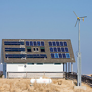 A building utilizing alternative energy - solar power, wind turbine and propane gas. Island Beach State Park, New Jersey