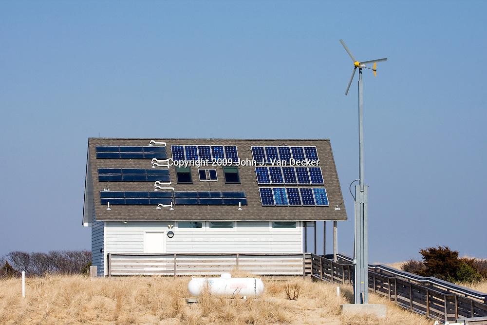 A building utilizing alternative energy - solar power, wind turbine and propane gas. Island Beach State Park, New Jersey