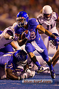 004-09-2015 Boise Idaho The Washington Huskies take on the Boise State Broncos on the blue turf. The Friday night season opener for both teams marks the return of former Boise Stat head coach Chris Petersen , now the head coach of Washington. The Broncos held off Washington for a 16-13 win.