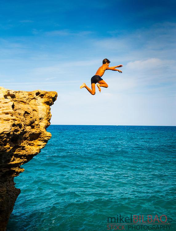 Cliff jump. Cala Moreta. Begur. Costa Brava, Gerona. Catalonia, Spain, Europe