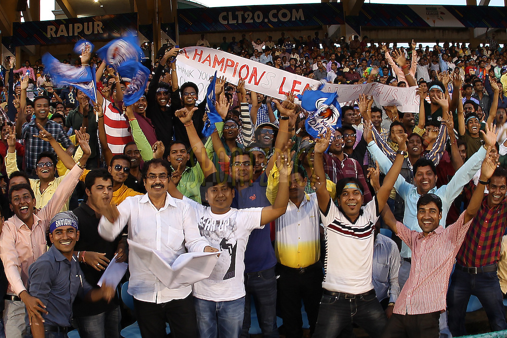 Fans enjoy the atmosphere during the qualifier 1 match of the Oppo Champions League Twenty20 between the Northern Knights and the Southern Express held at the Chhattisgarh International Cricket Stadium, Raipur, India on the 13th September 2014<br /> <br /> Photo by:  Ron Gaunt / Sportzpics/ CLT20<br /> <br /> <br /> Image use is subject to the terms and conditions as laid out by the BCCI/ CLT20.  The terms and conditions can be downloaded here:<br /> <br /> <br /> http://sportzpics.photoshelter.com/gallery/CLT20-Image-Terms-and-Conditions-2014/G0000IfNJn535VPU/C0000QhhKadWcjYs