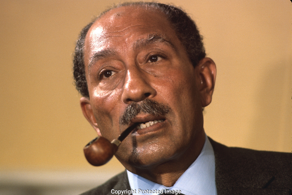Anwar Sadat answers a question during a press conference at Blair House in March 1977...Photograph by Dennis Brack bb 21