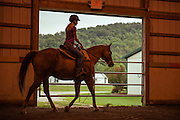 Therapeutic riding instructor Katie Bantz rides a horse prior to a therapy session at the Ohio Horse Park near Ohio University's Southern Campus.