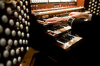 "25 November, 2008. New York, NY. Bruce Neswick, the director of music of the Cathedral of St. John the Divine, tests the ""new"" organ. The organ at the Cathedral of St. John the Divine, heavily damaged in a fire in 2001, has been rebuilt. The organ has been tuned for the last couple of weeks.  ©2008 Gianni Cipriano for The New York Times<br /> cell. +1 646 465 2168 (USA)<br /> cell. +1 328 567 7923 (Italy)<br /> gianni@giannicipriano.com<br /> www.giannicipriano.com"