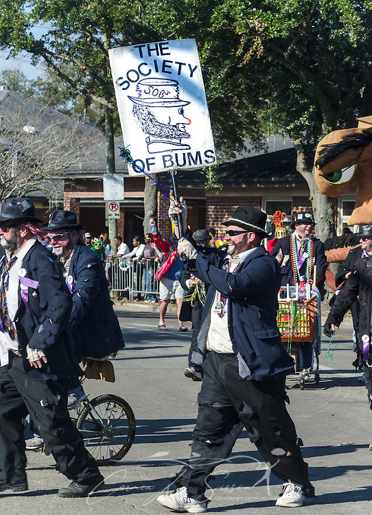 The Society of Bums marches down Washington Street in downtown Mobile, Ala., during the Joe Cain Procession at Mardi Gras, March 2, 2014. French settlers held the first Mardi Gras in 1703, making Mobile's celebration the oldest Mardi Gras in the United States. (Photo by Carmen K. Sisson/Cloudybright)