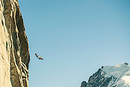 A BASE jumper leaves the Aiguille du Midi above Chamonix, in a wingsuit.