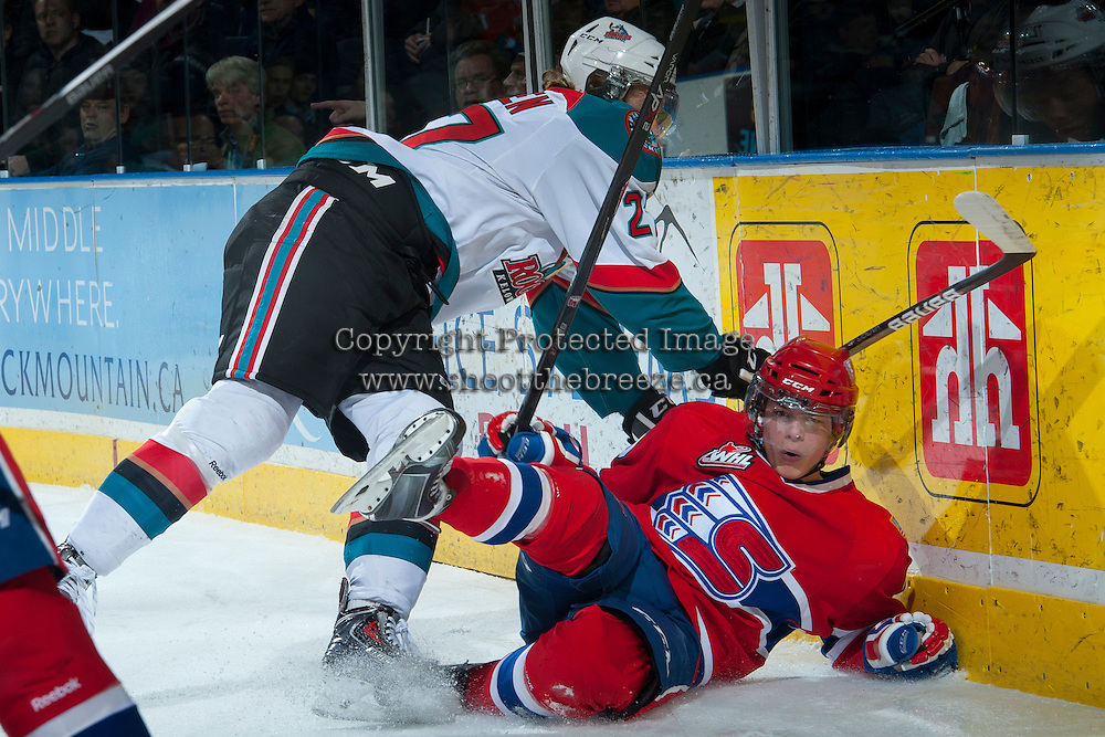 KELOWNA, CANADA -JANUARY 29: Ryan Olsen #27 of the Kelowna Rockets checks a player of the Spokane Chiefs into the boards during first period on January 29, 2014 at Prospera Place in Kelowna, British Columbia, Canada.   (Photo by Marissa Baecker/Getty Images)  *** Local Caption *** Ryan Olsen;