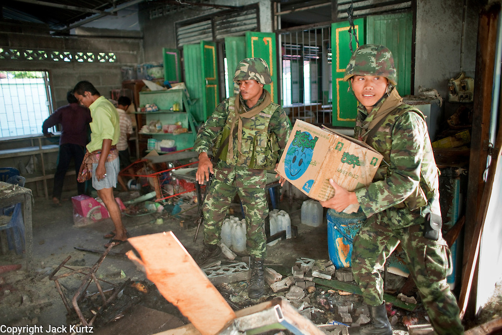 "Sept. 29, 2009 -- YARANG, THAILAND: Thai soldiers clean up after a mysterious explosion in an elementary school office in rural Pattani province, Sept. 29. Muslim militants frequently target schools because they claim the public schools are a symbol of the Bangkok government. No one was hurt in the explosion and the official cause of the blast was undetermined.  Thailand's three southern most provinces; Yala, Pattani and Narathiwat are often called ""restive"" and a decades long Muslim insurgency has gained traction recently. Nearly 4,000 people have been killed since 2004. The three southern provinces are under emergency control and there are more than 60,000 Thai military, police and paramilitary militia forces trying to keep the peace battling insurgents who favor car bombs and assassination.   Photo by Jack Kurtz / ZUMA Press"