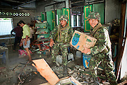 """Sept. 29, 2009 -- YARANG, THAILAND: Thai soldiers clean up after a mysterious explosion in an elementary school office in rural Pattani province, Sept. 29. Muslim militants frequently target schools because they claim the public schools are a symbol of the Bangkok government. No one was hurt in the explosion and the official cause of the blast was undetermined.  Thailand's three southern most provinces; Yala, Pattani and Narathiwat are often called """"restive"""" and a decades long Muslim insurgency has gained traction recently. Nearly 4,000 people have been killed since 2004. The three southern provinces are under emergency control and there are more than 60,000 Thai military, police and paramilitary militia forces trying to keep the peace battling insurgents who favor car bombs and assassination.   Photo by Jack Kurtz / ZUMA Press"""