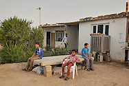 04/07/2015 -- Dibaga-Makhmur-, Iraq -- Young displaced boys sit in the courtyard of the chicken farm where they have been living since January 2015, after that their village  fell into the hands of ISIS.