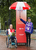 Jennifer Browning (GBR) the third placed rider at the medal ceremony for the Womens Handcycle Classic at Prudential RideLondon, the world's greatest festival of cycling, involving 70,000+ cyclists – from Olympic champions to a free family fun ride - riding in five events over closed roads in London and Surrey over the weekend of 9th and 10th August. <br /> <br /> Photo: Neil Turner for Prudential Ride London<br /> <br /> Sunday 10th August 2014<br /> <br /> See www.PrudentialRideLondon.co.uk for more.<br /> <br /> For further information: Penny Dain 07799 170433<br /> pennyd@ridelondon.co.uk