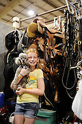 Youth from around the world converged on Oklahoma City for the American Quarter Horse Assocation (AQHA) Youth World horse show at the Oklahoma City Fairgrounds.  Each participant had to qualify either at the state or national level to compete.  All contestants under age 18 and horse must be owned by them or a direct family member...Niha Kearns with her dog hanging out at show.  Her mom Valerie is a trainer for several competitors.