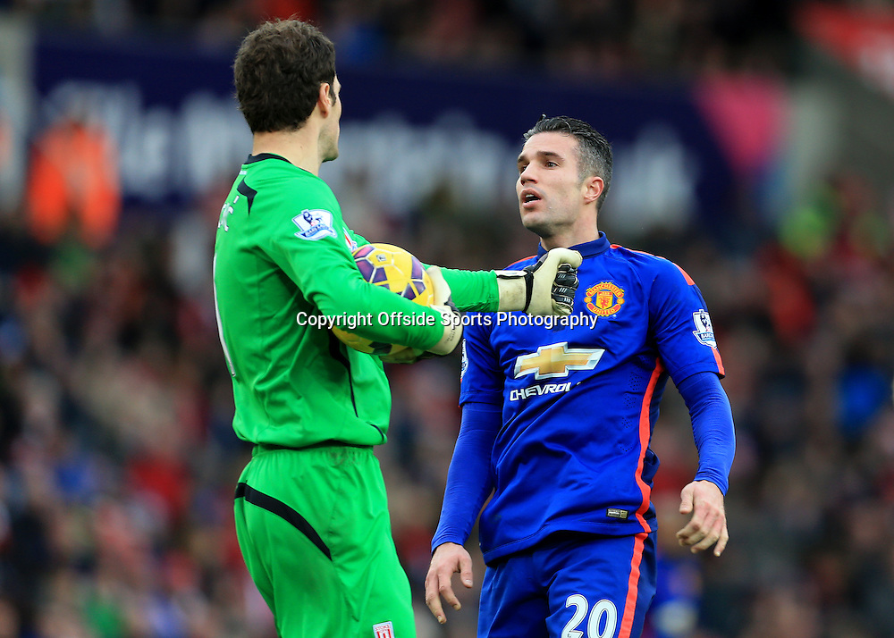 1st January 2015 - Barclays Premier League - Stoke City v Manchester United - Robin van Persie of Man Utd clashes with Stoke goalkeeper Asmir Begovic - Photo: Simon Stacpoole / Offside.