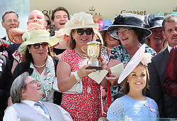 Winning connections with thr trophy pose with Ellie Simmonds after the Queen Mary Stakes during day two of Royal Ascot at Ascot Racecourse.