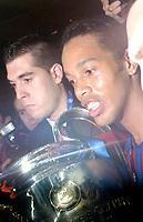 Photo: Richard Lane.<br />Arsenal v Barcelona. UEFA Champions League Final. 17/05/2006.<br />Barcelona's Ronaldinho celebrates with the trophy.