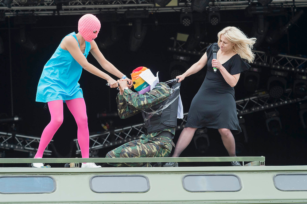 Pussy Riot argue with a fake Putin and then are interviewd by Charlotte Church on the top of an army lorry at the Park Stage. The 2015 Glastonbury Festival, Worthy Farm, Glastonbury.