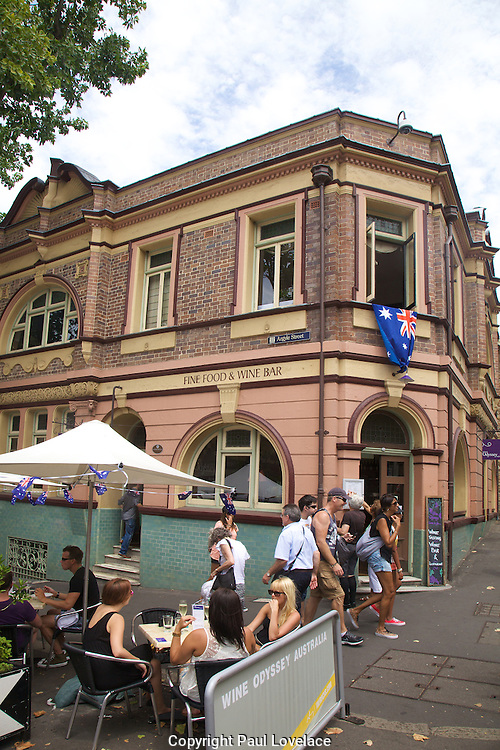 Australians celebrate Australia Day at The Rocks, Sydney, Australia..26th Jan 2013.Wine Odyssey Australia .Built in 1886, the Wine Odyssey Australia building was originally known as the British Seaman's Hotel. But the site's association with wine (and other less cultivated forms of alcohol) goes back to the 1840s, when it was owned by Australia's first female entrepreneur, Rosetta Terry.