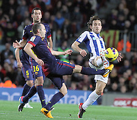 06.01.2013 Barcelona, Spain. La Liga day 18. Picture show Andres Iniesta and Verdu in action during game between FC Barcelona against RCD Espanyol at Camp Nou