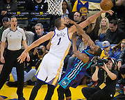 Golden State Warriors center JaVale McGee (1) blocks a lay up by Charlotte Hornets guard Kemba Walker (15) at Oracle Arena in Oakland, Calif., on February 1, 2017. (Stan Olszewski/Special to S.F. Examiner)