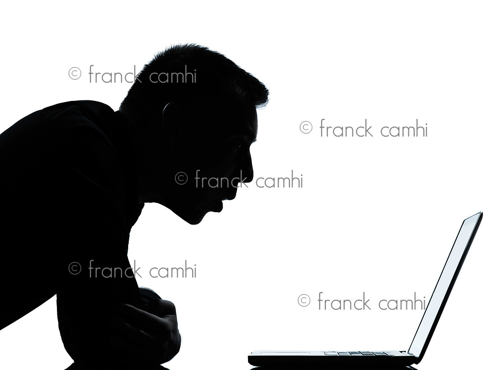 one caucasian business man computing computer laptop surprised portrait silhouette in studio isolated on white background